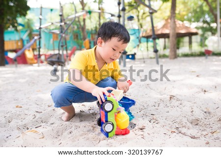 little child playing at playground - stock photo