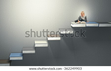 little child read on abstract books stair - stock photo