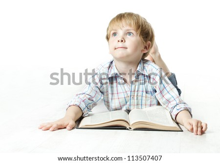 Little child reading book  lying down on floor and dreaming - stock photo