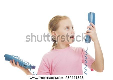 Little child speaking on the phone - stock photo