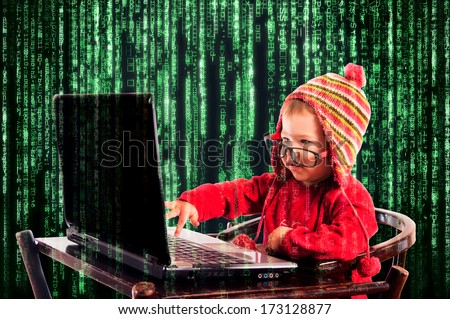 Little child typing on the keyboard.Selective focus on the child - stock photo