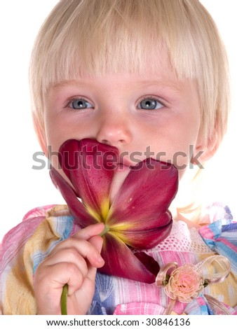 little child with red tulip - stock photo