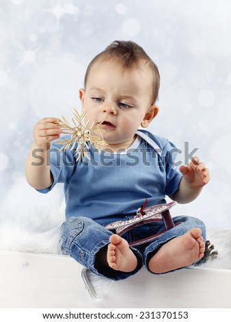 Little child with straw christmas decoration - stock photo