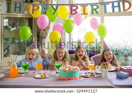 Little children at a birthday party - stock photo