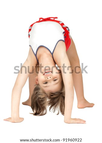 little children girl  stand head over heels and smile, on white background, isolated - stock photo