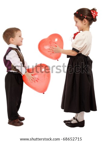 Little children give each other red balloons, isolated on white - stock photo