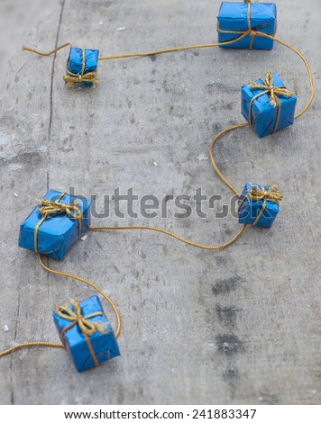 Little christmas gifts on wood board - stock photo