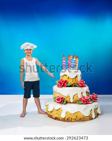 Little confectioner with a birthday cake - stock photo