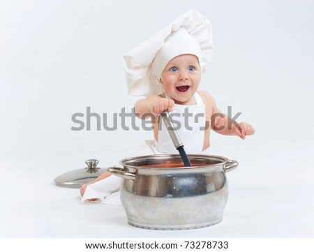 Little cook. Cute little boy in a suit of Food Boy with kitchen accessories. In the studio - stock photo