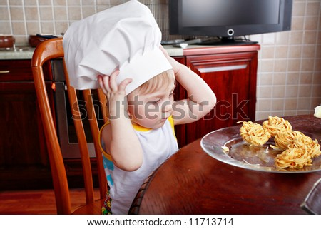 Little cook: fruits and baby food - stock photo