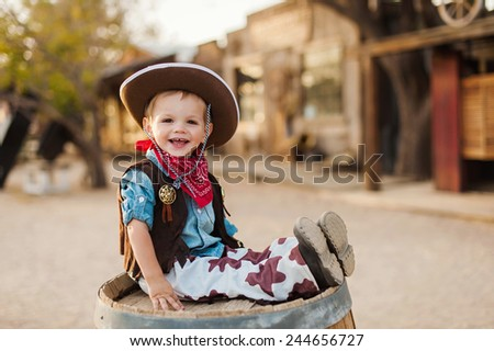 Little Cowboy in Old West Town - stock photo