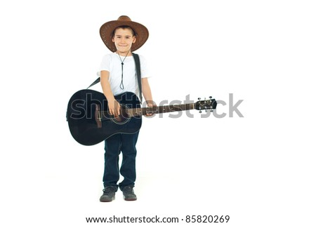 Little cowboy with hat playing guitar isolated on white background - stock photo