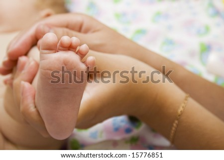 Little cute baby foot - stock photo