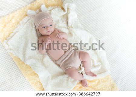 little cute baby in a rabbit suit - stock photo