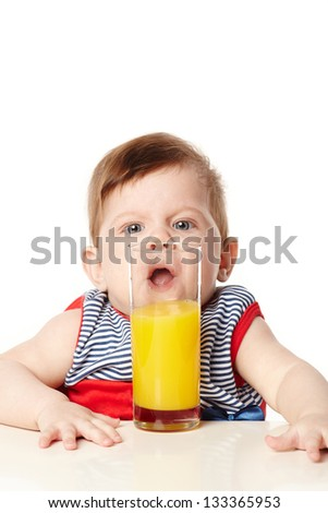 little cute baby with glass of juice - stock photo
