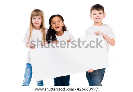 little cute boy and girl holding an empty paper sheet isolated on white background - stock photo