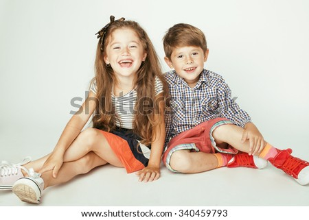 little cute boy and girl hugging playing on white background, happy family brother and sister - stock photo