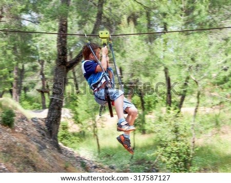Little cute boy hanging and runs track, leisure on nature - stock photo