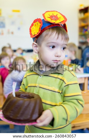Little cute boy having birthday party at kindergarden - stock photo