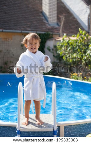 Little cute boy in a big swimming pool - stock photo
