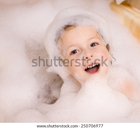 little cute boy in bathroom with bubbles close up - stock photo