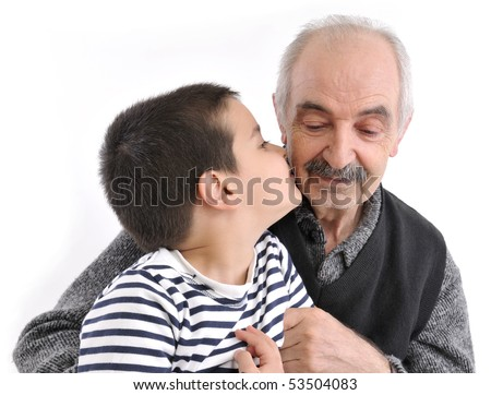 Little cute boy kissing his grandfather - stock photo