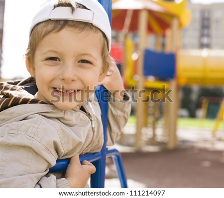 little cute boy on swing outside - stock photo