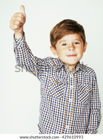 little cute boy on white background gesture smiling closeup, thumbs up - stock photo