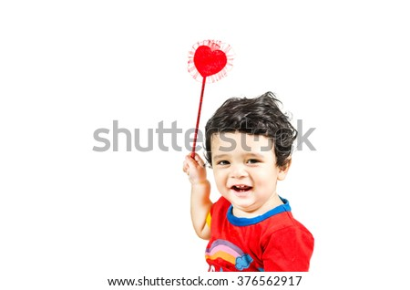 Little  cute boy posing with love symbol & smiling isolated in white background - stock photo