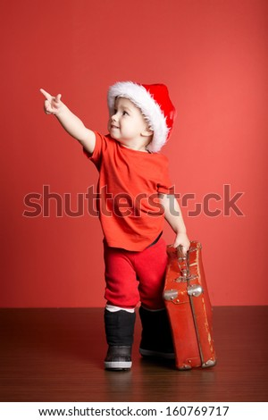 little cute boy with christmas suitcase - stock photo