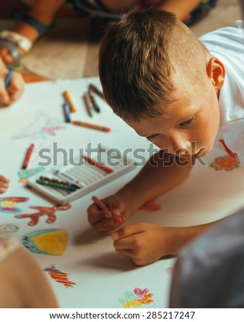 little cute boy with company painting on birthday party together - stock photo