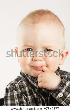 little cute boy with finger in mouth - stock photo