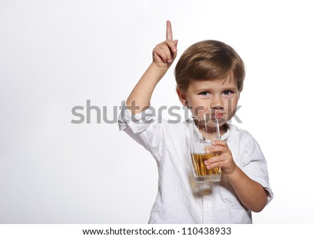 Little cute boy with glass of apple juice in white background. - stock photo