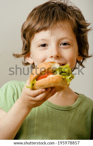 little cute boy with hamburger - stock photo