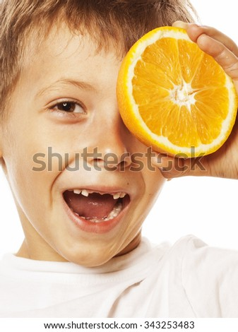 little cute boy with orange fruit double isolated on white smiling without front teeth adorable close up - stock photo