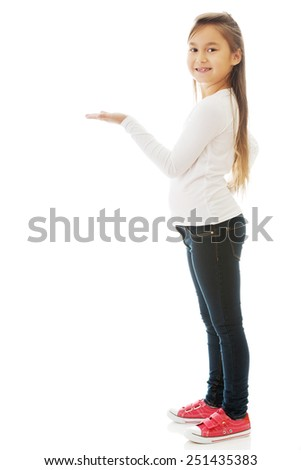 Little cute brunette girl showing something - stock photo