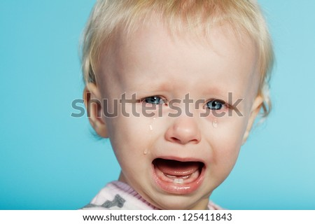 little cute child with tears on face - stock photo