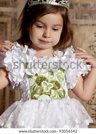 little cute girl in white dress with a tiara on her head - stock photo