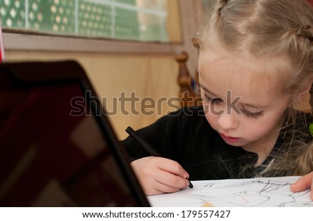 Little cute girl is drawing - stock photo