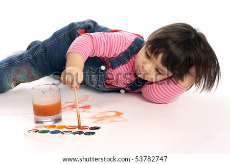 little cute girl is painting - stock photo