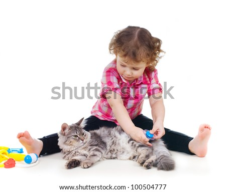 little cute girl plays doctor with cat on white background - stock photo