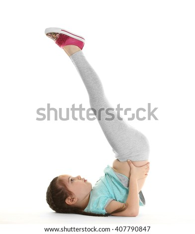 Little cute girl practicing yoga pose, isolated on white - stock photo