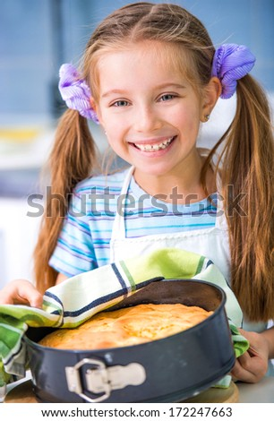 little cute girl showing apple pie that she baked - stock photo