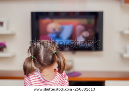 little cute girl watching tv - stock photo