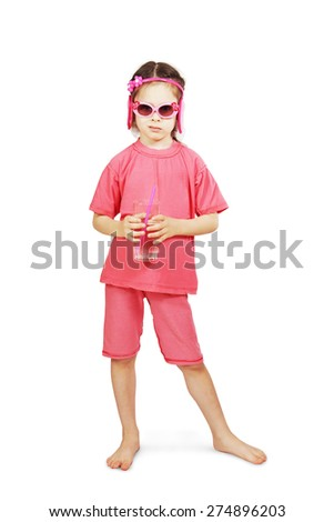 Little cute girl wearing pink clothes stands with a glass of water - stock photo