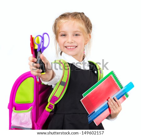 little cute girl with a stationery on a white background - stock photo