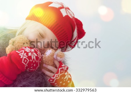 Little cute girl with Christmas bear in hands - stock photo