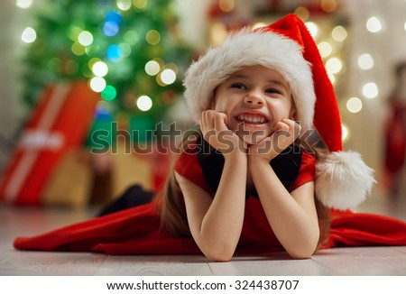 little cute girl with Christmas gifts - stock photo