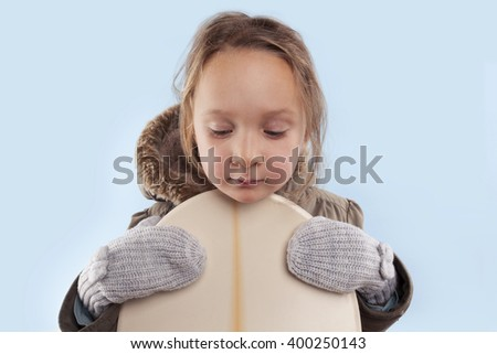 Little cute girl with snowboard. Winter. - stock photo