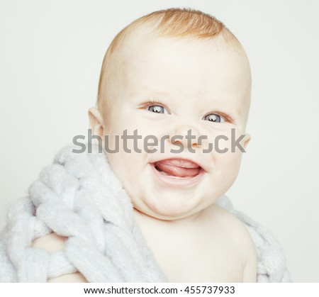 little cute red head baby in scarf all over him close up isolated, adorable kid - stock photo